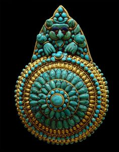 "Tibetan pendant called ""jewelry of ancient Kings."" Gold and turquoises."