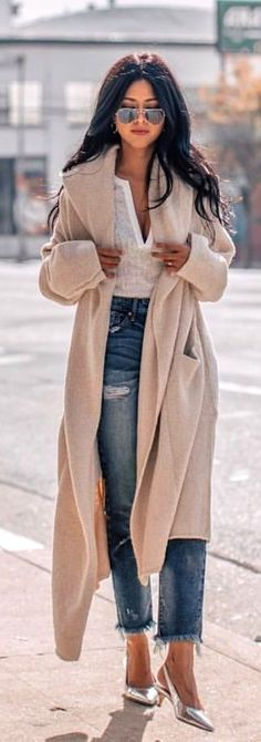 #spring #outfits  woman in brown long cardigan with white shirt and blue denim jeans standing on road during daytime. Pic by @best__outfits__
