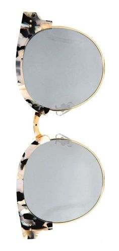 Cruising the beach on a sunny day in these retro round sunglasses with a semi-rimless frame by Gentle Monster.