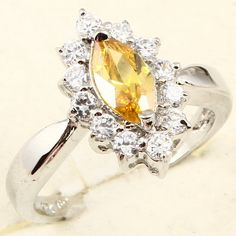 'Dazzling 18K WGP Yellow Sapphire Ring-Sz. 8' is going up for auction around 8pm EST Tue, Apr 9 with a starting bid of $7.  @Tophatter