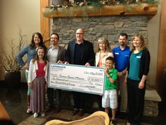 Lennar Seattle team handing a check over to the Tacoma Rescue Mission!