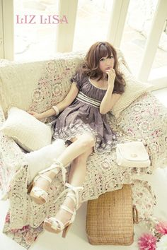 Cute, sweet gyaru: Purple/gray, chiffon dress with white, lace details. Sheer, white tights. White sandals with heels. White bag.