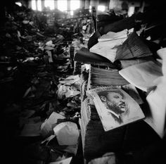 Abandoned dream: A book about Dr. Martin Luther King entitled 'Living the Dream' lies in Detroit Public Schools' abandoned book depository. What few schools remain open are racially segregated