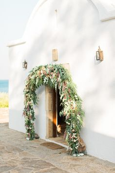 Photographed by Anna Roussos, this summer wedding in the Greek Islands had a color palette of creams, tans, green, and taupes with gold and navy accents. Flower Landscape, Floral Event Design, Event Planning Design, Island Weddings, Rustic Elegance, Wedding Events, Wedding Tables, Wedding Flowers, Wedding Arches