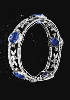 An Art Deco sapphire and diamond bracelet, by Chaumet, early 20th century. Designed as a semi flexible open work band, set with circular-cut diamonds, highlighted with five oval faceted sapphires. ~ETS