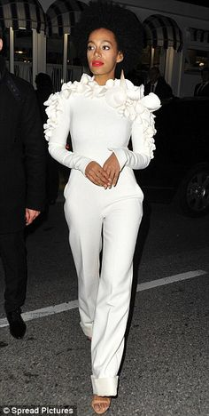 White delight: Solange Knowles stood out from the crowd in a startling bright jumpsuit that boasted ruffled and conical detailing around the neckline and arms