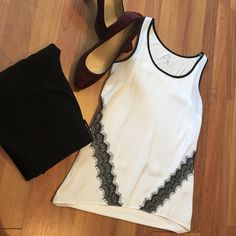 Gorgeous lace lined tank  Gorgeous lace lined top from NYC. Paired with black slacks from NYC and calf hair Calvin Klein shoes; both are available in my closet. Thanks for looking! New York & Company Tops Tank Tops