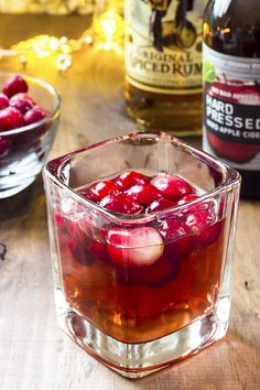 This easy spiced cranberry cider cocktail recipe uses only three ingredients - rum, cranberry juice and hard cider. Perfect for your holiday parties! Easy Drink Recipes, Coffee Recipes, Yummy Drinks, Cocktail Recipes, Juice Recipes, Pina Colada, Cranberry Juice Benefits, Cider Cocktails