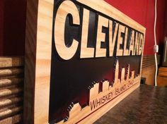 x Cleveland Ohio Whiskey Island Wooden Carved Sign Bar Signs Man Cave City Skyline Pictures Gifts Custom Wood Signs Wood Wall Art via Etsy Carved Wood Signs, Custom Wood Signs, Gifts For Him, Great Gifts, Cave City, Picture Gifts, Cleveland Ohio, Bar Signs, College Life