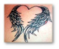 Interesting winged heart tattoo... maybe in memory of someone passed?