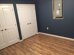Finished Basement Remodel Project Walls Painted With Smoky Blue By Sherwin Williams With Laminate Flooring
