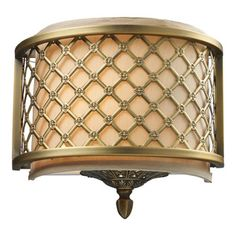 ELK - Chester 1-Light Sconce, Brushed Antique Brass - The Distinguished Metal Lace Pattern, Finished In Brushed Antique Brass, Is The Principle Design Feature Which Envelopes A Rich Cream Fabric Shade. A Frosted Amber Glass Diffuser Completes The Design While Masking The Direct Light For A Warm, Ambient Radiance.