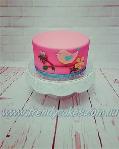 9b27ba0c8919 Little birdie cake. This baby shower cake for a little girl was inspired by  the serviettes bought for the table setting