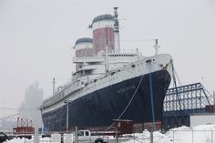 Once the holder of the Blue Riband, the SS United States lies tied and abandoned to a dock in Maryland.