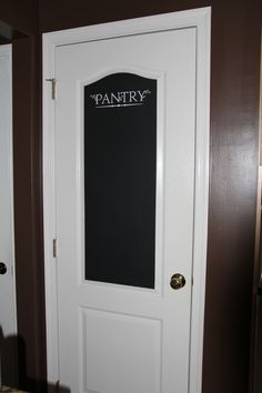 we have 4 white doors in one entryway so I added chalkboard paint and a stencil to make one known it's not the garage door! :)