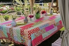 """Cherry Menlove's Summer Tablecloth Two layers of fabric, the top one being pieced rectangles. Border has mitered corners. No batting used, thus it is really a """"summer quilt"""" that she purposely made to fit the size of her table."""