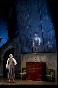 Stage set for The Turn of the Screw, Opera North. Window and Jessel too much, but chairs and chest of drawers are nice.