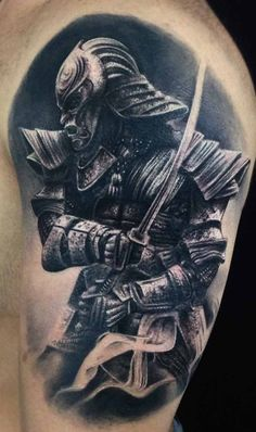 An absolutely imposing and stunning black and gray arm tattoo of a Samurai. This Samurai is done in such a way it looks like a replica of a photo, capturing perfectly the reflection of the light on the helmet and armor is hallucinating. It gives you the impression of a Samurai lurking in the shadows on under the light of a full moon.