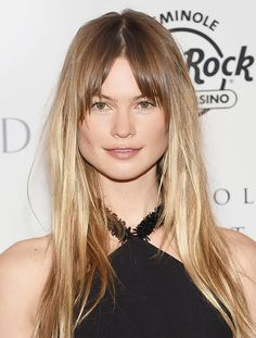 Behati Prinsloo with straight hair and center-parted bangs
