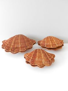 RESERVED    Set of 3 gorgeous wicker clam baskets. Simply beautiful with so much texture and a glossy shine too. Perfect for the beach house decor. Each shell sits perfectly inside the other. Good condition with little wear.    Largest basket is 10 1/2 x 8 1/2 x 4 1/2.    ———————————————————————————————››❖‹‹———————    shop  http://www.etsy.com/shop/simplychi    policies  http://www.etsy.com/shop/simplychi/policy?ref=shopinfo_policies_leftnav    ♥ chi