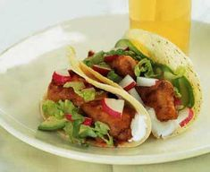 Fried fish tacos   1 quart vegetable oil 12 to 16 corn tortillas 1 cup all-purpose flour 2 teaspoons salt 1 cup beer (not dark) 1 pound cod fillet, cut into 3- by 1-inch strips