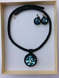 Set with swarovski and black matte Toho, beaded cord, the earhooks are sterling silver by HandmadeIDanielle on Etsy