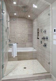 Stand Up Shower Tub Combo. BATH in Shower area  Add Steam Standing white pebble tile on shower wall and floor by katheryn Small Bathroom Ideas With Tub And Tile Work All Over The