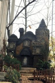 A charming fairy stone house, solid with age and character.  Wouldn't you just like to stroll through and have a look? Oh, I would.