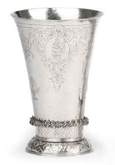 A Dutch silver beaker  Groningen, 1656/57, maker's mark indistinct  The flared body on a cast and domed foot decorated with foliage and cherubs below a band of trelliswork and flowerheads, with a spike twist band, the lower part of the body engraved with three flowers and inscribed LF, the upper part with three oval cartouches with figures emblematic of Faith, Hope and Charity with festoons of fruit in between, marked on base  13 cm. high  162 gr.