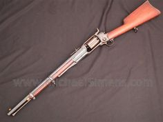 This is a Colt Revolving Rifle in 56 caliber with its original bayonet, sling swivels and rare barrel. We collect, buy, sell & authenticate Colt Revolving Rifles and Colt Percussion Firearms and Accessories. Weapons Guns, Guns And Ammo, Arma Steampunk, Armas Wallpaper, Revolver Rifle, Black Powder Guns, Concept Weapons, Hunting Guns, Gun Holster
