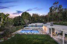 Grand backyard w/ full sports court, pool & spa, outdoor trellis