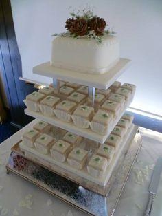 Fondant fancies, cake, handmade sugar flower arrangement by Truly Scrumptious, Wedding & Events, Peterborough.  www.truly-scrumptious-events.co.uk