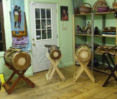 Three sizes of the bass dundun drums are shown.
