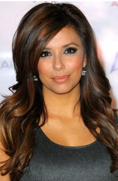 Eva Longoria long layers and side bang with a 2013 burnt brown hair color