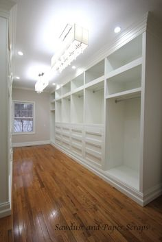 A dream closet! Well, if I ever win the lottery (Im talking enough to still have money leftover after traveling the world putting my kids through college)... then Ill build my dream home, with a closet like this filled with beautiful clothes.