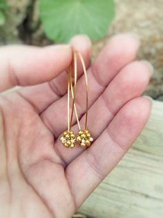 Golden drop dangle earrings.  Nature inspired by CallOfEarth, $35.00