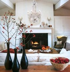 black vases and berries for the mantle