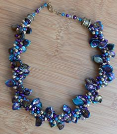 Kumihimo Necklace - love the mix of leaf beads, very pretty!