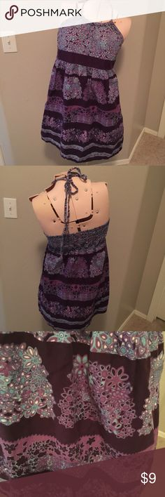 """Beautiful purple/blue floral halter dress Sadly, I have to reposh this dress as it is a little shorter than I would like. It is a beautiful halter dress with a purple, blue and white floral design. The top is padded so no bra is needed. Length is 27"""". I am 5'5"""" and it comes a little higher than mid thigh on me. Bust: 34"""". I am selling this dress for what I paid. No Boundaries Dresses Mini"""