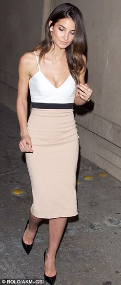A vision: Lily Aldridge was lovely in a white top-over-beige skirt ensemble tied together with a black band around her slender waist