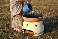 Italian designer, Gabriele Diamanti develops a simple and reproducable design for a solar powered water filter made from terracotta, anodized zinc,  and recycled plastic.