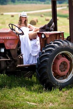 on a John Deere Green tractor Bridal Poses, Bridal Shoot, Wedding Poses, Bridal Hairdo, Wedding Dresses, Quirky Wedding, Trendy Wedding, Perfect Wedding, Cowgirl Wedding