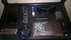 Kyocera hydro air Smith and Wesson border gaurd Chapstick Shades Zippo Fisher space pen bullet Leatherman Wingman S shock watch Wallet Ultrafire cree flashlight