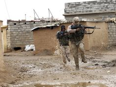 Iraqi Army soldiers secure streets in a recently liberated