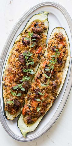Stuffed Zucchini is a great way to use up those extra large zucchini from the garden. Stuff with Italian sausage, onions, garlic, tomato, and fresh breadcrumbs, and bake!