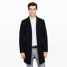 $525, Black Overcoat: Club Monaco Cotton Topcoat. Sold by Club Monaco. Click for more info: https://lookastic.com/men/shop_items/168825/redirect