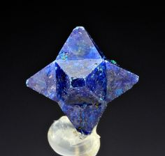 Cumengite - Mexico. On a fully developed specimen, each of the six faces of the boleite's cube are capped with a four sided pyramid of cumengite. The resulting aggregate is a true mineralogical curiosity, a six pointed, 3 dimensional, indigo blue star. There are not many complete specimens in existence and even partial stars are valuable.
