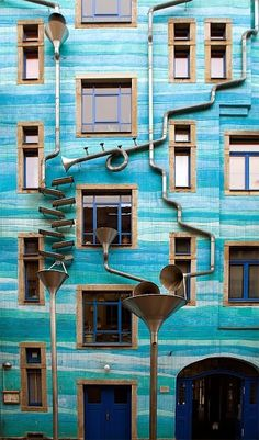 A building located in Dresden, Germany, that plays music when it rains. It's called Neustadt Kunsthofpassage. And when it rains it starts to play music. Amazing Architecture, Architecture Design, Dresden Germany, Parasols, Building Facade, Blue Building, When It Rains, Picture Day, The Places Youll Go