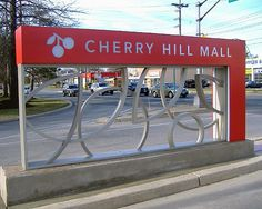 Design by JPRA Architects designed this Cherry themed sign family to include tasteful letterforms, shapes, and colors to provide a variable yet coherent branding for the mall complex. L&H met the fabrication challenge and produced a precise and excellent sign product.