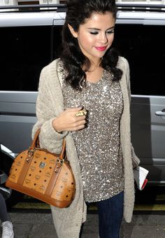 Steal The Look / Daytime Glitz Selena Gomez shows us how to wear sequins in the daytime without looking overdone. BOYFRIEND CARDIGAN A slouchy boyfriend cardigan is the perfect topper to the glamorous sweater underneath.